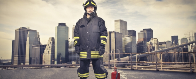 fireman in front of city
