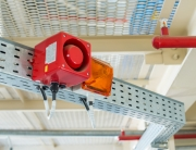 The fire alarm system. The combination of sound and light alert.