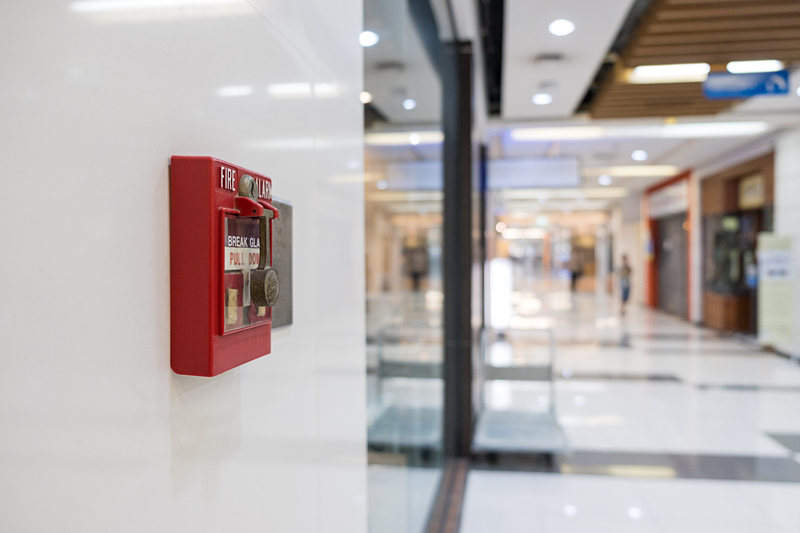 Fire alarm on the wall of shopping mall warning and security system