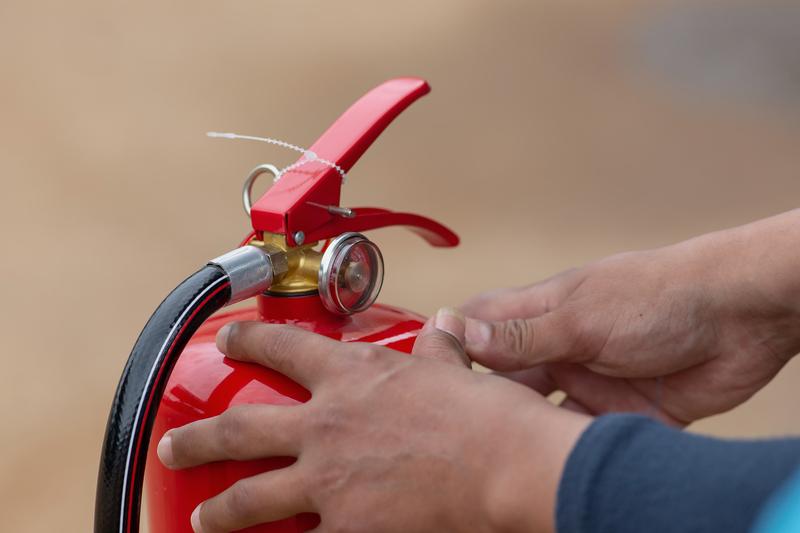 fire extinguisher man showing during trai
